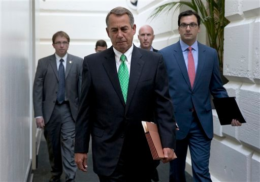 House Speaker John Boehner of Ohio arrives for a caucus meeting on Capitol Hill in Washington, Wednesday, Oct. 21, 2015. Rep. Paul Ryan, R-Wis. is seeking unity in a place it's rarely found, telling House Republicans he will serve as their speaker only if
