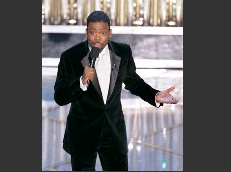 In this Feb. 27, 2005 file photo, Chris Rock hosts the 77th Academy Awards telecast in Los Angeles. Rock will return to host the Oscars for a second time. The show's producers say the prolific comedian-filmmaker will be at the helm for the 88th Oscars.