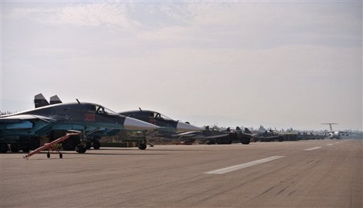 A lineup of Russian combat jets at Hemeimeem airbase, Syria, on Thursday, Oct. 22, 2015. Since early morning, Russian combat jets have been taking off from this base in western Syria, heading for missions. (AP Photo/Vladimir Isachenkov)