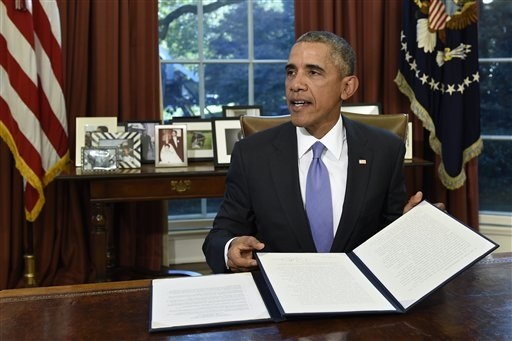 President Barack Obama vetoes the National Defense Authorization Act (NDAA), Thursday, Oct. 22, 2015, in the Oval Office of the White House in Washington. The president vetoed the sweeping $612 billion defense policy bill, citing objections over how the m