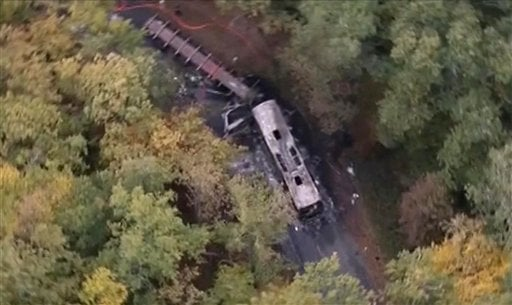 In this aerial photo taken from video, showing the scene after a truck and a bus transporting retirees on a day trip collided and caught fire Friday in wine country in southwest France, killing 42-people.