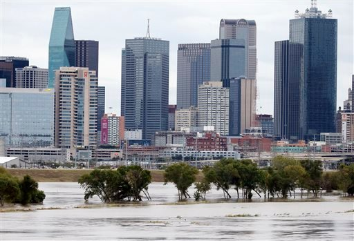 The rain-swollen Trinity River is seen with the city skyline in the background Saturday, Oct. 24, 2015, in Dallas. Southeast Texas was bracing for heavy rain late Saturday and into Sunday as the remnants of Hurricane Patricia combined with a powerful stor