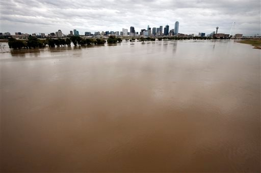 The rain-swollen Trinity River is seen leading up to the city skyline Saturday, Oct. 24, 2015, in Dallas. Southeast Texas was bracing for heavy rain late Saturday and into Sunday as the remnants of Hurricane Patricia combined with a powerful storm system
