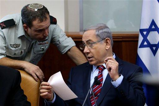 Israel's Prime Minister Benjamin Netanyahu speaks his military secretary Brigadier General Eliezer Toledano, left, during the weekly cabinet meeting at his office, in Jerusalem, Sunday, Oct. 25, 2015. (Gali Tibbon/Pool Photo via AP)
