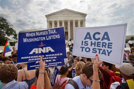 In this June 25, 2015, file photo, supporters of the Affordable Care Act hold up signs as the opinion for health care is reported outside of the Supreme Court in Washington. Opponents of President Barack Obama's health care overhaul are taking yet another