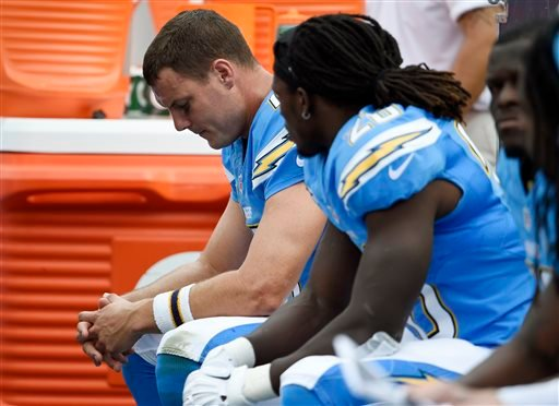 San Diego Chargers quarterback Philip Rivers, left, sits on the sidelines next to teammate running back Melvin Gordon, right, during the second half of an NFL football game against the Oakland Raiders, Sunday, Oct. 25, 2015, in San Diego. (AP Photo/Denis
