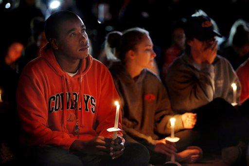 Oklahoma State University senior William Brown listens to a prayer during a vigil on campus Sunday, Oct. 25, 2015, in Stillwater, Okla. (Sarah Phipps/The Oklahoman via AP)