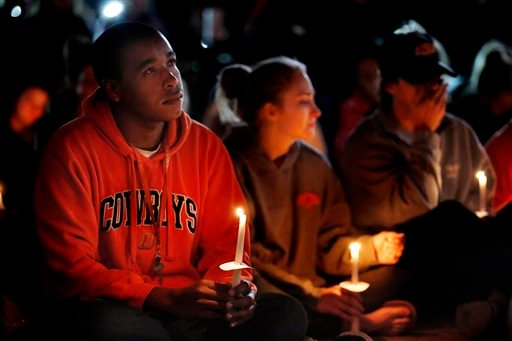 Oklahoma State University senior William Brown listens to a prayer during a vigil on campus Sunday, Oct. 25, 2015, in Stillwater, Okla. (Sarah Phipps/The Oklahoman via AP)