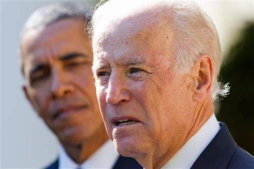 In this Oct. 21, 2015, file photo, President Barack Obama listens as Vice President Joe Biden speaks in the Rose Garden of the White House in Washington. (AP Photo/Jacquelyn Martin, File)