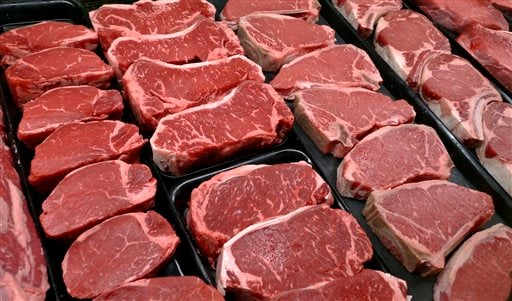 In this Jan. 18, 2010 file photo, steaks and other beef products are displayed for sale at a grocery store in McLean, Va. The meat industry is seeing red over the dietary guidelines. The World Health Organization's cancer agency says Monday Oct.26, 2015 t