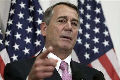 Outgoing House Speaker John Boehner of Ohio talks with reporters on Capitol Hill in Washington, Tuesday, Oct. 27, 2015. House Republican leaders on Tuesday pushed toward a vote on a two-year budget deal despite conservative opposition, relying on the back
