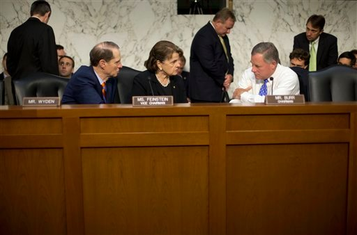 In this Sept. 24, 2015 file photo, Senate Intelligence Committee Chairman Sen. Richard Burr, R-N.C., right, confers with committee Vice-Chair. Sen. Dianne Feinstein, D-Calif., center, and committee member Sen. Ron Wyden, D-Ore., on Capitol Hill in Washing