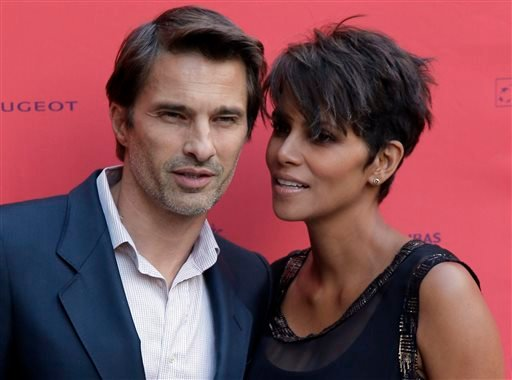 """In this June 13, 2013 file photo, actor and president of the Champs-Elysees Film Festival Olivier Martinez, left, poses with Actress Halle Berry prior to the screening of the film """"Things We Lost in the Fire""""."""