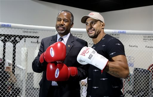 UFC middleweight fighter Vitor Belfort poses with presidential candidate Ben Carson at the OTB Fight gym in Coconut Creek, Fla. Belfort is endorsing Carson. (Susan Stocker/South Florida Sun-Sentinel via AP)
