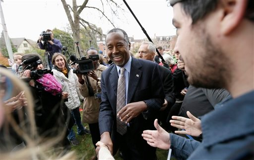 In this Oct. 24, 2015, photo, Republican presidential candidateBen Carson greets audience members after speaking outside the Alpha Gamma Rho fraternity at Iowa State University during a campaign stop in Ames, Iowa. Carson and the other Republican presiden