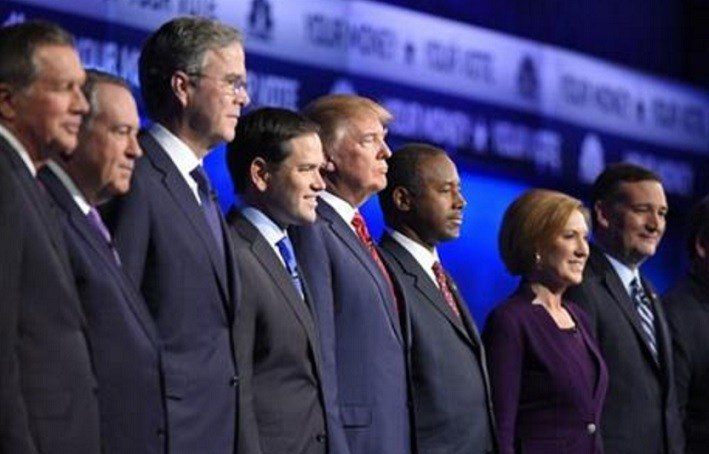 Republican presidential candidates, from left, John Kasich, Mike Huckabee, Jeb Bush, Marco Rubio, Donald Trump, Ben Carson, Carly Fiorina, and Ted Cruz take the stage during the CNBC Republican presidential debate at the University of Colorado, Wednesday.