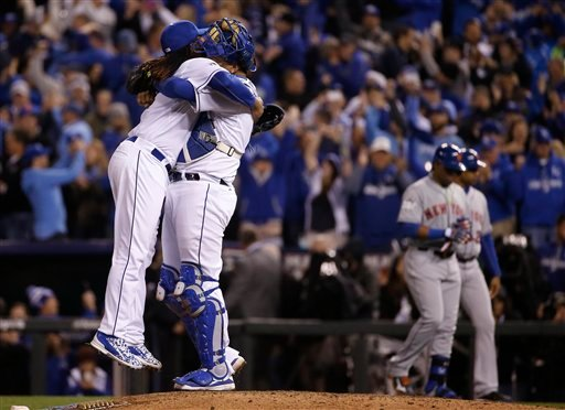 Kansas City Royals catcher Salvador Perez, right, hugs starting pitcher Johnny Cueto at the end of Game 2 of the Major League Baseball World Series against the New York Mets.