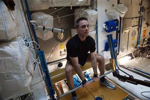 In this Aug. 31, 2013 photo made available by NASA, astronaut Chris Cassidy, Expedition 36 flight engineer, exercises on the advanced Resistive Exercise Device (aRED) in the Tranquility node of the International Space Station. In an extensive audit releas
