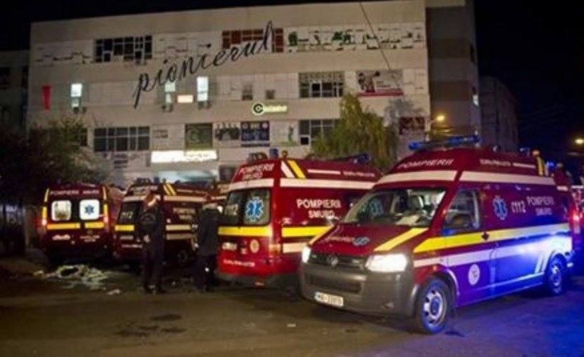 A heavy metal band's pyrotechnical show sparked a deadly fire Friday at a Bucharest nightclub, killing more than 20 people and injuring scores of the club's mostly youthful patrons, officials and witnesses said. (AP Photo/Vadim Ghirda)