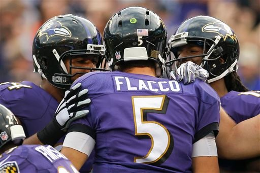 Baltimore Ravens quarterback Joe Flacco (5) is congratulated by his teammates after scoring a touchdown during the second half of an NFL football game against the San Diego Chargers in Baltimore, Sunday, Nov. 1, 2015. (AP Photo/Patrick Semansky)
