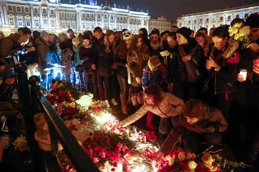 People light candles during a day of national mourning for the plane crash victims at Dvortsovaya (Palace) Square in St. Petersburg, Russia, on Sunday, Nov. 1, 2015. The Metrojet charter crashed Saturday morning 23 minutes after taking off from Egypt's Re