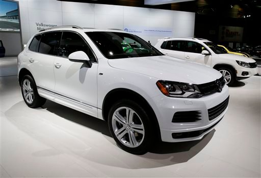 In this Feb. 7, 2014 file photo, the 2014 Volkswagen Touareg TDI R-Line is on display during the media preview of the Chicago Auto Show at McCormick Place in Chicago. The U.S. government says Volkswagen cheated a second time on emissions tests, programmi