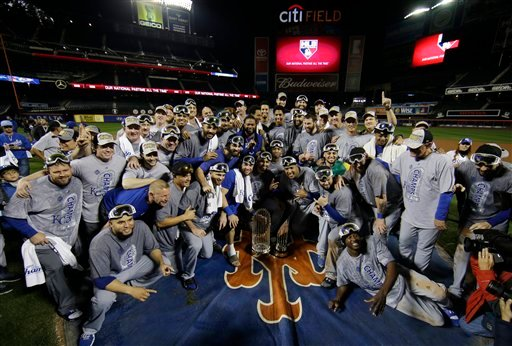 Kansas City Royals pose with World Series trophy after Game 5 of the Major League Baseball World Series against the New York Mets Monday, Nov. 2, 2015, in New York.