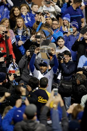 Kansas City Royals center fielder Jarrod Dyson carries the trophy after Game 5 of the Major League Baseball World Series against the New York Mets Monday, Nov. 2, 2015, in New York.