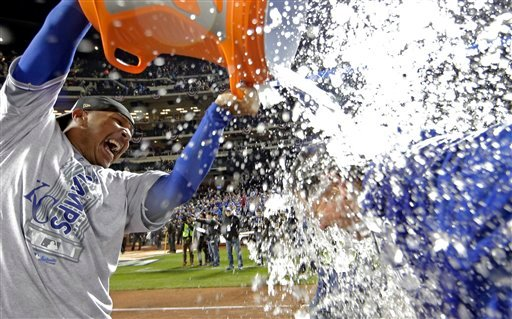 Kansas City Royals' Salvador Perez dunks manager Ned Yost after Game 5 of the Major League Baseball World Series against the New York Mets Monday, Nov. 2, 2015, in New York.