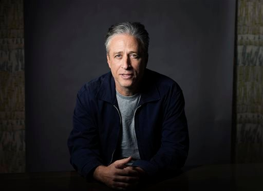 "In this Nov. 7, 2014 file photo, Jon Stewart poses in New York. Fresh from ""The Daily Show,"" Stewart has signed on with HBO in an exclusive four-year production pact. HBO said Tuesday, Nov. 3, 2015, the partnership will start with short-form digital conte"