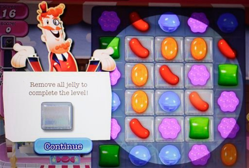 """In this March 24, 2014, file photo, a detail from the online game """"Candy Crush Saga"""" is shown on a computer screen in New York."""