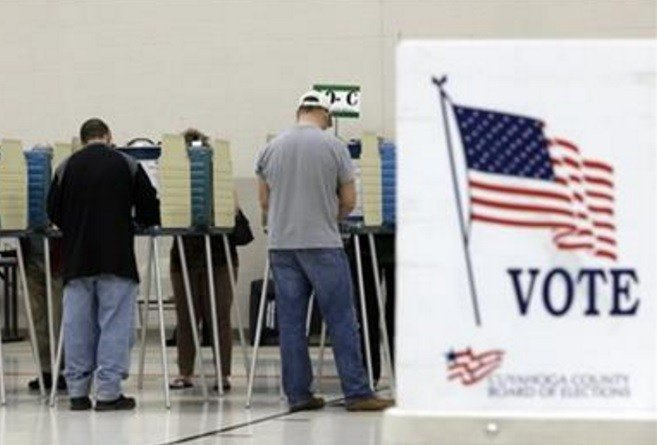 Election officials in two of Ohio's counties say lines of voters dwindled some after an early wave of Ohioans who cast their ballots early in the state's general election. (AP Photo/Tony Dejak)