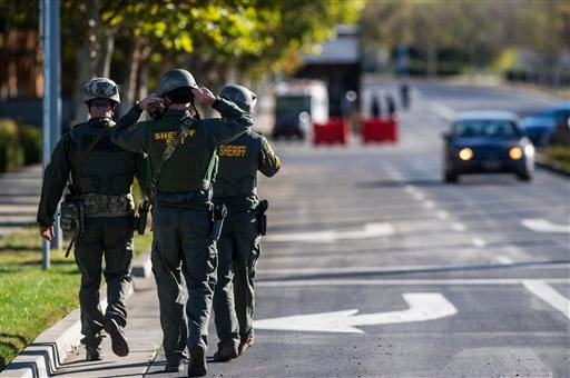 Merced County Sheriff SWAT members enter the University of California, Merced campus after a reported stabbing in Merced, Calif., Wednesday, Nov. 4, 2015. An assailant stabbed five people on the rural university campus in central California before police