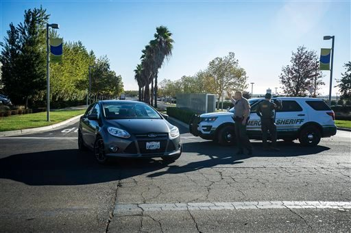 Merced County Sheriff deputies direct traffic out of the University of California, Merced, as the campus is placed on lockdown after a stabbing in Merced, Calif., Wednesday, Nov. 4, 2015. An assailant stabbed five people as students headed to class at the