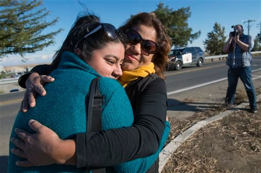 University of California, Merced studenKaren Bustamante, 18, hugs her mom Gloria Bustamante of San Leandro, Calif., after she left the UC Merced campus following a stabbing in Merced, Calif., Wednesday, Nov. 4, 2015.