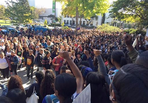 Berkeley High School students who walked out of class hold a protest in reaction to reports of racist slurs found the day before on a school library computer in Berkeley, Calif., Thursday, Nov. 5, 2015. The message referred to the Ku Klux Klan, using dero