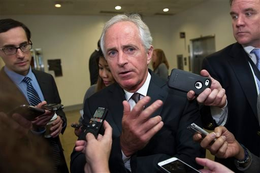 In this Oct. 27, 2015, file photo, Senate Foreign Relations Committee Chairman Sen. Bob Corker, R-Tenn., speaks with reporters on Capitol Hill in Washington. In the fight against the Islamic State group, members of Congress talk tough on extremism, but mo