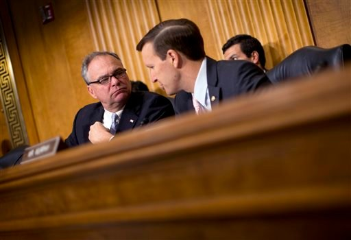 In this July 9, 2014, file photo, Senate Foreign Relations Committee members Sen. Tim Kaine, D-Va., left, and Sen. Christopher Murphy, D-Conn., participate in a committee hearing on Capitol Hill in Washington. In the fight against the Islamic State group,