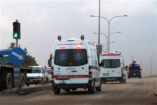 Ambulances leave the King Abdullah bin Al Hussein Training Center where a Jordanian policeman went on a shooting spree in Mwaqar on the outskirts of Amman, Jordan, Monday, Nov. 9, 2015. The policeman opened fire Monday on foreign trainers at a police comp