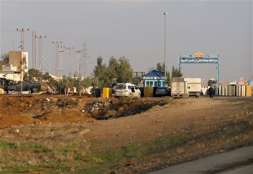 Ambulances leave the King Abdullah bin Al Hussein Training Center where a Jordanian policeman went on a shooting spree in Mwaqar on the outskirts of Amman, Jordan, Monday Nov. 9, 2015. The policeman opened fire Monday on foreign trainers at a police compo