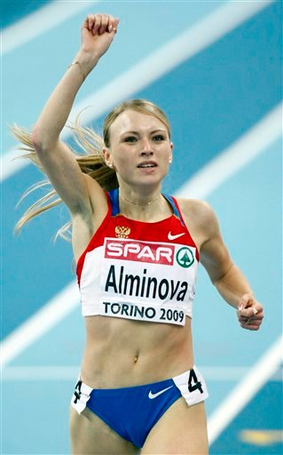 In this March 7, 2009 file photo Russia's Anna Alminova celebrates as she wins the gold medal in the final of the Women's 1500m during the European Indoor Athletics Championships in Turin, Italy. (AP Photo/Luca Bruno, file)