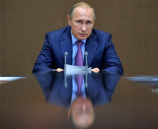 Russian President Vladimir Putin chairs a meeting with defense officials in the Bocharov Ruchei residence in the Black Sea resort of Sochi, Russia, Tuesday, Nov. 10, 2015. President Vladimir Putin said Tuesday that Russia will counter NATO's U.S.-led miss