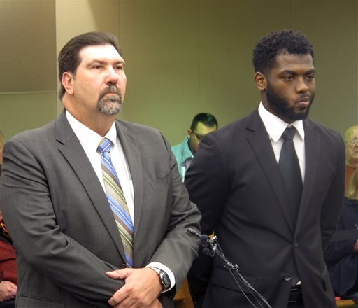 Ohio State quarterback J.T. Barrett, right, listens to Columbus Municipal Court Judge H. William Pollitt outline details of Barrett's plea to a count of driving while impaired, with defense attorney Phillip Templeton by his side, on Tuesday, Nov. 10, 2015