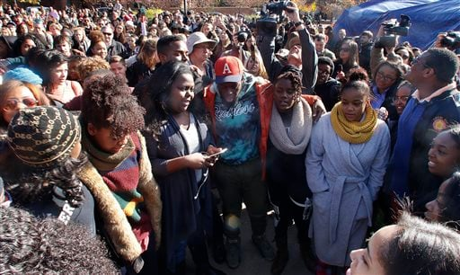 Supporters gather after the announcement that University of Missouri System President Tim Wolfe would resign Monday, Nov. 9, 2015, in Columbia, Mo. Wolfe resigned Monday with the football team and others on campus in open revolt over his handling of racia