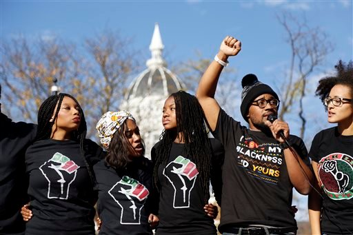 Concerned Student 1950, led by University of Missouri graduate student Jonathan Butler, second from right, speaks following the announcement that University of Missouri System President Tim Wolfe would resign Monday, Nov. 9, 2015, in Columbia, Mo. Wolfe r