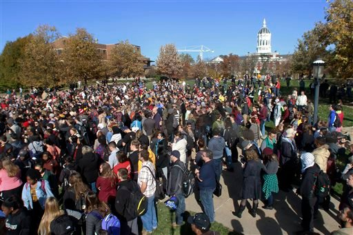 Members of Concerned Student 1950, University of Missouri's Graduate Professional Council, faculty and student supporters gather at Mel Carnahan Quadrangle to rally in support of an ongoing protest to get UM System President Tim Wolfe to resign on Monday,
