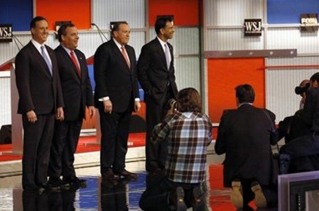 Republican presidential candidates Rick Santorum, Chris Christie, Mike Huckabee and Bobby Jindal take the stage during Republican presidential debate at Milwaukee Theatre, Tuesday, Nov. 10, 2015, in Milwaukee. (AP Photo/Morry Gash)