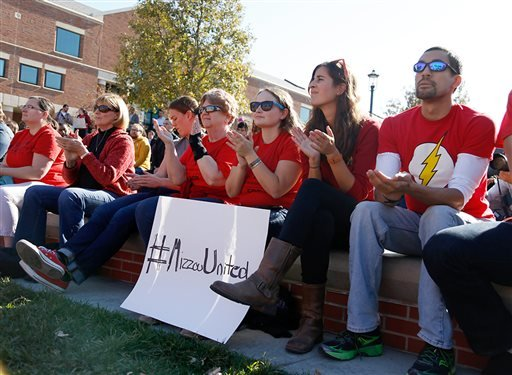 University of Missouri students clap as the co-chair of the Forum on Graduate Rights introduces speakers during a rally for graduate student rights at the University of Missouri campus Nov. 10, 2015 in Columbia, Mo. (Sarah Bell/Missourian via AP)