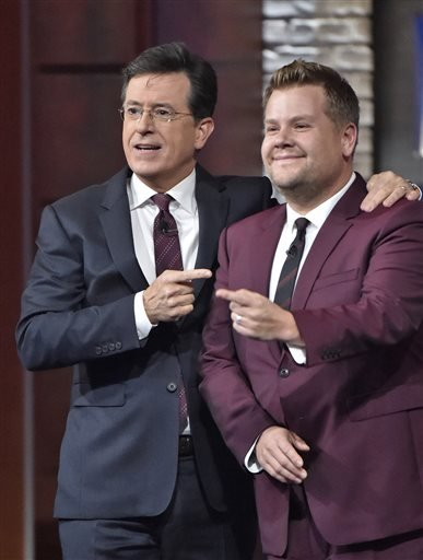 """In this Oct. 9, 2015 photo released by CBS, Stephen Colbert, host of """"The Late Show with Stephen Colbert"""", left, appears with James Corden, host of """"The Late Late Show with James Corden."""""""