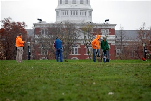 University of Missouri grounds maintenance workers begin to clean up Mel Carnahan Quad on the University of Missouri campus Wednesday, Nov.11, 2015, in Columbia, Mo. The Concerned Student 1950 activist group tent city was disassembled overnight after both